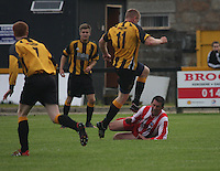 Craig Dorrat (11) tackles and injures Grant Carnochan in the Huntly v Wigtown & Bladnoch William Hill Scottish Cup 1st Round match, at Christie Park, Huntly on 25.8.12.