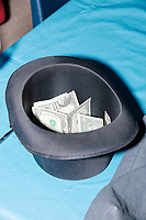 A hat filled with money stands on a table at the Milford Democrats' Potluck Supper at the Unitarian Universalist Congregation Church in Milford, New Hampshire, USA, on Sat., Apr. 6, 2019. Democratic presidential candidate and Congressional Representative Eric Swalwell (D-CA 15th) spoke at the event. Swalwell is running primarily on gun control issues.