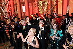 Guests at the Mardi Gras Ball at the Tremont House in Galveston wait for beads during the parade Saturday Feb. 13,2010.(Dave Rossman Photo)