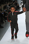 NFL Chicago Bears player Lamarr Houston walks runway with his children in outfits from the Jordan Fall 2017 collection, during the Rookie USA Fall 2017 kidswear fashion show, presented by Haddad Brands at NYFW: The Shows Fall 2017 at Skylight Clarkson Square on February 15, 2017.