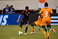 Mexico midfielder Angel Reyna (8) shoots and scores. Mexico defeated the Ivory Coast 4-1 during an international friendly at MetLife Stadium in East Rutherford, NJ, on August 14, 2013.