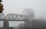 Fog along the Lake Washington Ship Canal. Ballard Railroad Trestle at West end of Chittenden lock. The Puget Sounder heading into Seattle.