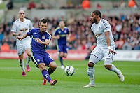 SWANSEA, WALES - MAY 17: Sergio Aguero of Manchester City  tries to get the ball past Ashley Williams of Swansea City   during the Premier League match between Swansea City and Manchester City at The Liberty Stadium on May 17, 2015 in Swansea, Wales.  (photo by Athena Pictures)