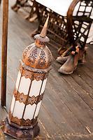 Detail of a beaten metal floor lantern