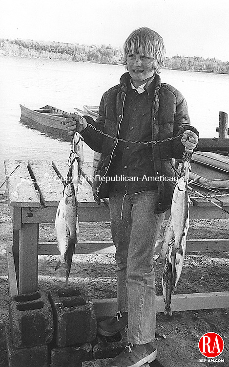 April 17, 1977 - LAKEVILLE - Fishing Season Opens - David Brown, of Meriden, shows the limit catch he pulled in at Lake Wononscopomuc in Lakeville. Republican-American Archives