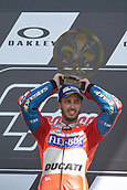 June 4th 2017, Mugello Circuit, Tuscany, Italy; MotoGP Grand Prix of Italy, Race day; Andrea Dovizioso on podium as he takes the winners trophy