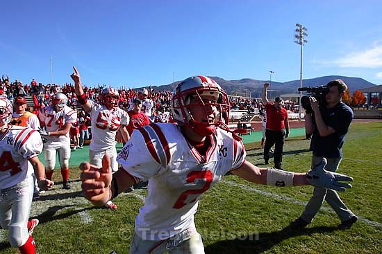 Kanab's Mitchell Glazier runs onto the field as time runs out and Kanab wins the state championship. Kanab vs. Enterprise, 1A State Football Championship game at Southern Utah University's Eccles Stadium in Cedar City.<br />