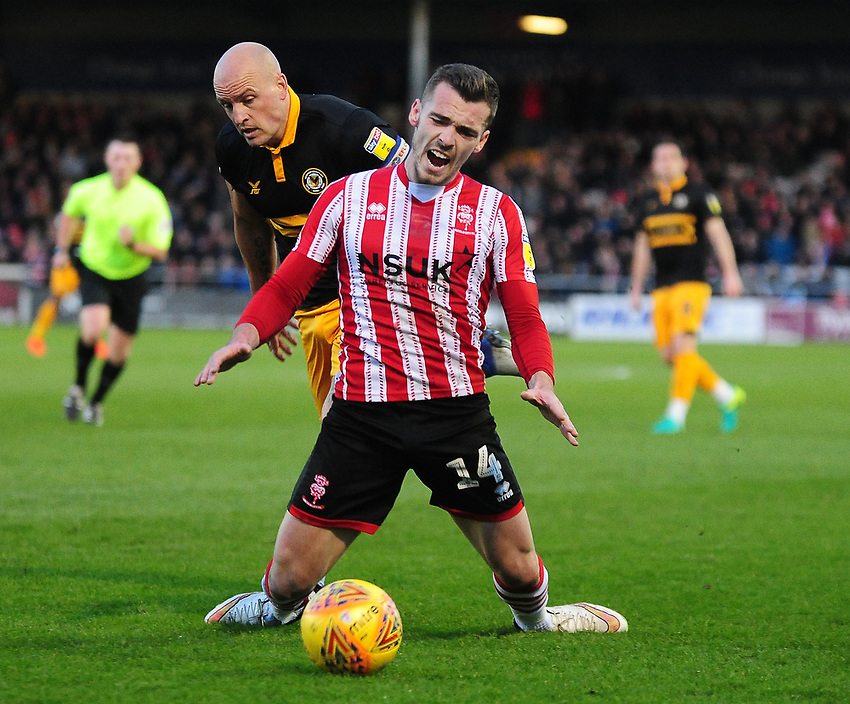 Lincoln City's Harry Toffolo is fouled by Newport County's David Pipe<br /> <br /> Photographer Andrew Vaughan/CameraSport<br /> <br /> The EFL Sky Bet League Two - Lincoln City v Newport County - Saturday 22nd December 201 - Sincil Bank - Lincoln<br /> <br /> World Copyright © 2018 CameraSport. All rights reserved. 43 Linden Ave. Countesthorpe. Leicester. England. LE8 5PG - Tel: +44 (0) 116 277 4147 - admin@camerasport.com - www.camerasport.com