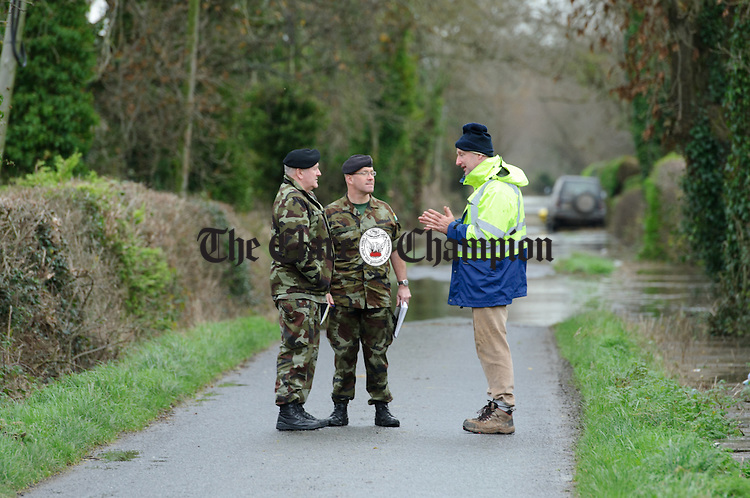 Clare County Council engineer Hugh Mc Grath talking with Army personnel in Springfield Clonlara as residents prepare for flooding due to water being released at the Parteen Weir. Photograph by John Kelly.