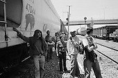 Ecatepec, Mexico<br /> June 4, 2007<br /> <br /> In the train station named Lechería, central and south Americans who had ventured north to Mexico City, mainly from Honduras, (but also from Guatemala and El Salvador),  jump the trains to take them north. Most of them had been traveling for one or two weeks. The train guards allowed them to travel and pointed out which train would take them to Monterrey where they could find a train to the USA border. Stories are abound of those killed while trying to jump the trains and police brutality.