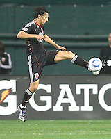 Juan Manuel Pena #3 of D.C. United pulls in a high ball during an MLS match against the New England Revolution on April 3 2010, at RFK Stadium in Washington D.C.