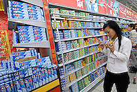 A customer crest toothpaste in a supermarket in Chengdu, China. Crest is a leading brand in the Chinese market and made by Proctor and Gamble who have a wide reach into the mainland market with several household products..20 Sep 2006