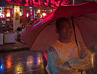 The famous Pub Street is all colourful at night during a heavy rain shower, Monsoon Season, Siem Reap Cambodia