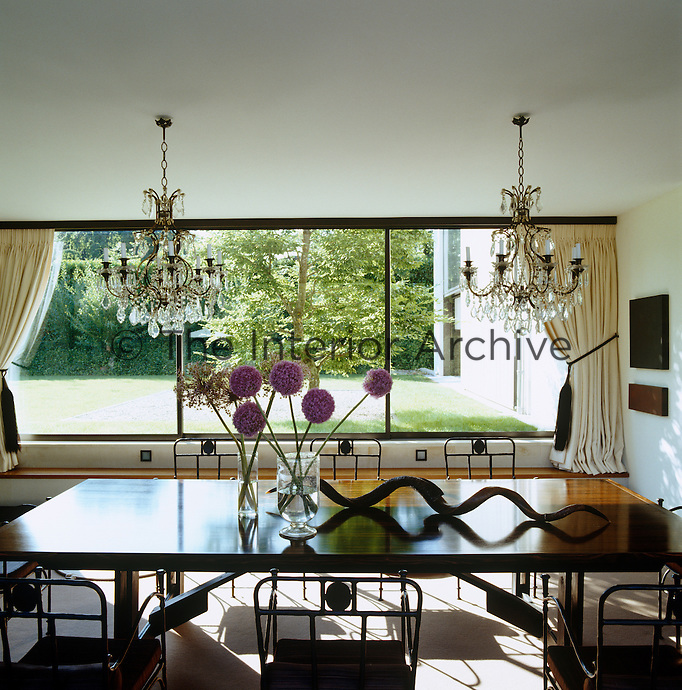 The dining room is furnished with 19th century chandeliers and a table by Alexandra de Garidel-Thoron