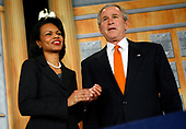 United States Secretary of State Condoleezza Rice, left, applauds as she introduces US President George W. Bush, right, White House will make remarks to the US University Presidents Summit on International Education at the U.S. State Department in Washington, DC on January 5, 2006.<br /> Credit: Jay Clendenin - Pool via CNP
