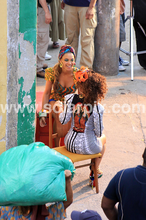 **ALL ROUND PICTURES FROM SOLARPIX.COM**.**SYNDICATION RIGHTS FOR UK AND SPAIN ONLY**.American singers Beyonce Knowles and Alicia Keys filming their new duet music video in Santa Marta slum, in Rio de Janeiro, Brazil. 10 February 2010..This pic: Beyonce Knowles and Alicia Keys..JOB REF: 10677 PRT        DATE: 10_02_2010.**MUST CREDIT SOLARPIX.COM OR DOUBLE FEE WILL BE CHARGED**.**MUST NOTIFY SOLARPIX OF ONLINE USAGE**.**CALL US ON: +34 952 811 768 or LOW RATE FROM UK 0844 617 7637**