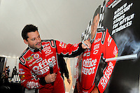 Tony Stewart signs a stand up of himself at hospitality.