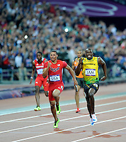 Usain Bolt (JAM) running the last leg of the 4x100m relay beats Ryan Baily to the line..Olympic Stadium.Olympic Park.Olympics 2012.London UK. .11/08/12,.photo: Sean Ryan / IPS Photo Agency.. mobile: 07971 400 939.Address: Thatched Cottage,Wretham,Thetford, Norfolk IP24 1RH .Office tel: 01953 499 403...