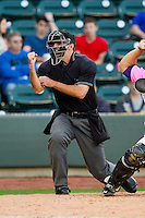 Home plate umpire Brennan Miller makes a strike call during the Carolina League game between the Wilmington Blue Rocks and the Winston-Salem Dash at BB&T Ballpark on April 20, 2013 in Winston-Salem, North Carolina.  The Dash defeated the Blue Rocks 4-2 in game one of a double-header.  (Brian Westerholt/Four Seam Images)