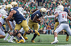 Sept. 26, 2015; Running back Josh Adams gains yardage during the first quarter against University of Massachusetts at Notre Dame Stadium. (Photo by Barbara Johnston/University of Notre Dame)