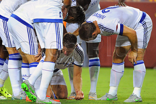 28.07.2015. Landover, Maryland, USA.   Chelsea defender Gary Cahill (24) kneels on the ground with a bloody nose after scoring a goal against Barcelona at FedEx Field in Landover, Md. in the second half where Chelsea defeated FC Barcelona, 3-2 on penalty kicks in the International Champions Cup.