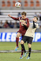 Houston, TX - Friday December 9, 2016:  Graham Smith (12) of the Denver Pioneers wins a header over Luis Argued (2) of the Wake Forest Demon Deacons in the first half of the NCAA Men's Soccer Semifinals at BBVA Compass Stadium.