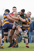 Matthew Vaai is tackled by Siosifa Pole and Tamati Fromm. Counties Manukau Premier Club Rugby Semi-final game between Patumahoe and Manurewa, played at Patumahoe on Saturday July 14th 2018. Patumahoe won the game 29 - 28 after trailing 7 - 14 at halftime. <br /> Photo by Richard Spranger.