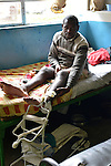 A man with a leg fracture in the surgery ward of Kibuye Hospital, Karongi District, Western Rwanda