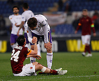 Calcio, Europa League: Ritorno degli ottavi di finale Roma vs Fiorentina. Roma, stadio Olimpico, 19 marzo 2015.<br /> Roma's Alessandro Florenzi, left, is comforted by Fiorentina's Marcos Alonso during the Europa League round of 16 second leg football match between Roma and Fiorentina at Rome's Olympic stadium, 19 March 2015.<br /> UPDATE IMAGES PRESS/Isabella Bonotto