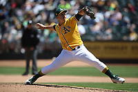 OAKLAND, CA - MAY 9:  Daniel Mengden #33 of the Oakland Athletics pitches against the Houston Astros during the game at the Oakland Coliseum on Wednesday, May 9, 2018 in Oakland, California. (Photo by Brad Mangin)