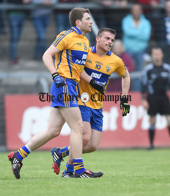 Sean Collins of Clare congratulates team mate Cathal Mc Inerney on a point  during their Championship game against Limerick in Ennis. Photograph by John Kelly.