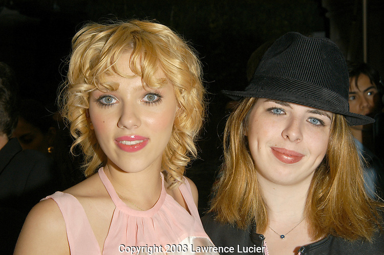 NEW YORK - SEPTEMBER 18: Actresses Scarlett Johanson (L) and Heather Matarazzo appear September 18, 2003, at the Cynthia Rowley Spring/Summer 2004 Collection fashion show at the Elizabeth Street Garden in New York City.