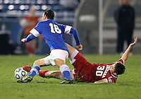 HOOVER, AL - DECEMBER 07, 2012:  Dylan Lax (30) of the University of Indiana slides the ball away from Timo Pitter (18) of Creighton University during an NCAA 2012 Men's College Cup semi-final match, at Regions Park, in Hoover , AL, on Friday, December 07, 2012. Indiana won 1-0.