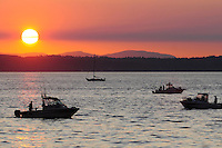 Daniel Berman/Special to The Enterprise..Fishing boats try and catch the last rays of sunshine on the Puget Sound off of Marina Park in Edmonds Friday July 31, 2009...Edmonds, WA