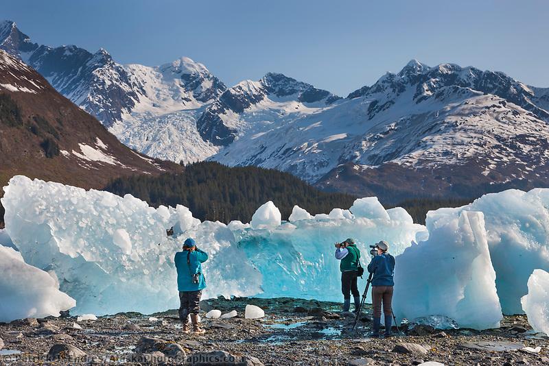 Tourists photograph stranded glacier icebergs along Harriman Fjord, northern Prince William Sound, Alaska.