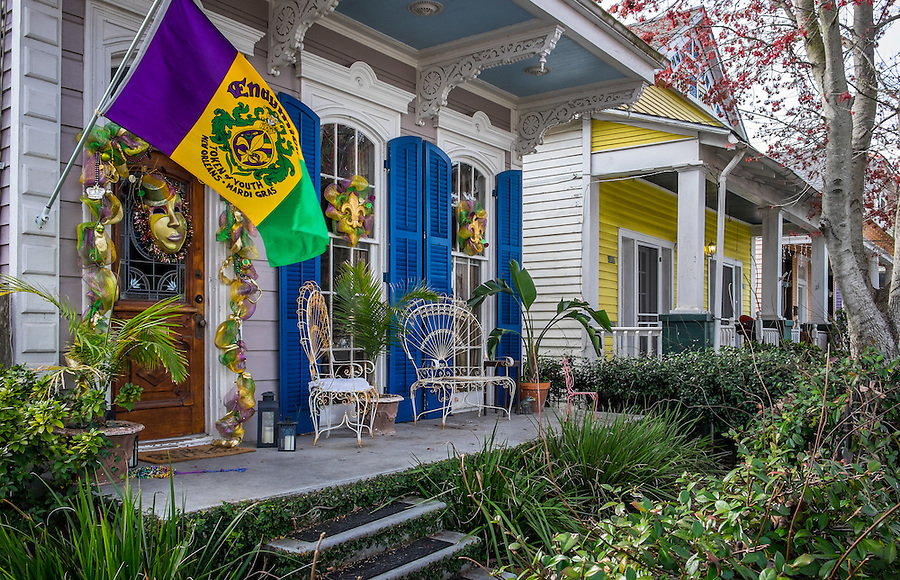 NEW ORLEANS - CIRCA FEBRUARY 2014: View of a typical house decorated with Mardi Gras accessories in Algiers Point, a popular community within the city of New Orleans in Louisiana.