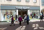 River Island shop shoppers walking in street, Tavern Street, Ipswich, Suffolk, England, UK
