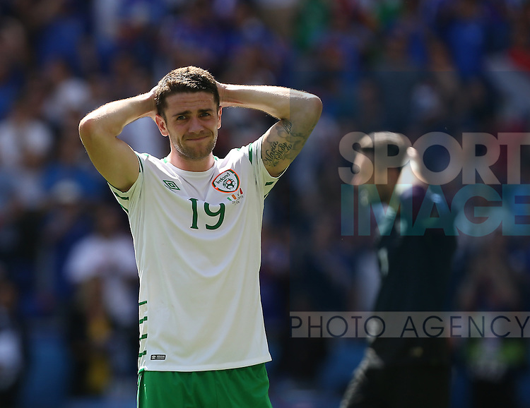 Robbie Brady of Ireland dejected after being knocked out of the tournament during the UEFA European Championship 2016 match at the Stade de Lyon, Lyon. Picture date June 25th, 2016 Pic Phil Oldham/Sportimage