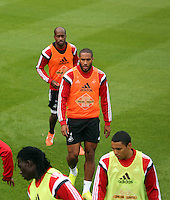 Pictured: Ashley Williams (C) followed by Dwight Tiendalli. . Thursday 14 August 2014<br /> Re: Swansea City FC training at Fairwood, south Wales, ahead of their first game of the Premier League season against Manchester United this coming Saturday.
