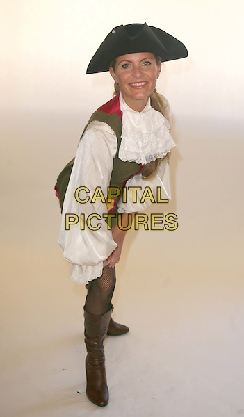 TRACY SHAW .Tracy Shaw stars as Robinson Crusoe at The Connaught Theatre Worthing for the forthcoming panto season..September 22nd, 2009.pantomime full length costume pirate fishnet stockings boots hat white shirt brown bending green.CAP/DS.©Dudley Smith/Capital Pictures