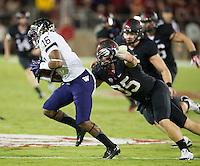 STANFORD, CA - October 5, 2013:  Stanford Cardinal linebacker Jarek Lancaster (35) makes a sack during the Stanford Cardinal vs the Washington Huskies at Stanford Stadium in Stanford, CA. Final score Stanford Cardinal 31, Washington Huskies  28.