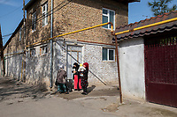 Uzbekistan - Tashkent - Neighbours gather in the narrow streets of Old Tashkent on a warm Spring day.