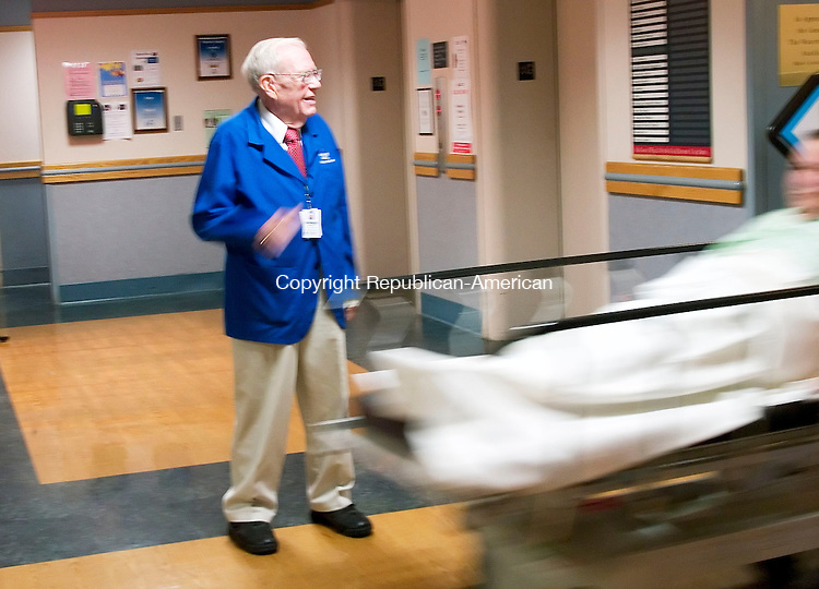 WATERBURY, CT- 24 OCT 2007- 102407JT03- <br /> Howard Parsons motions for a stretcher to pass through at his post as a greeter at Waterbury Hospital. The hospital named Parsons its Humanitarian of the Year.<br /> Josalee Thrift / Republican-American
