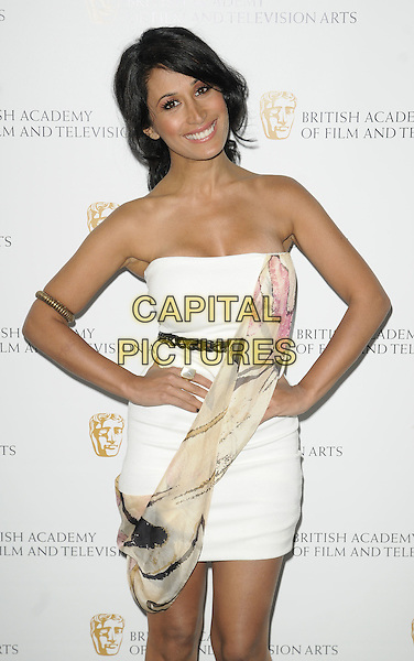 PREEYA KALIDAS .The British Academy TV Craft Awards 2011, The Brewery, London, England..May 8th, 2011.half length black belt white strapless dress mini wrap arm band hands on hips  cream  .CAP/CAN.©Can Nguyen/Capital Pictures.