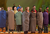 """London, UK. 19 November 2014. Chorus performing with Banks as Angel Gabriel and Meredith Arwady as Martha at the back. Peter Sellars directs the World Staged Premiere of John Adams's """"The Gospel According To The Other Mary"""" at the London Coliseum. A Passion Oratory in Two Acts, Libretto by Peter Sellars based on Old and New Testament sources and with texts by Dorothy Day, Louise Erdrich, Primo Levi, Rosario Castellanos, June Jordan, Hildegard von Bingen and Ruben Dario. An ENO co-production with Theater Bonn and The Royal Swedish Opera. With Patricia Bardon as Mary Magdalen, Meredith Arwady as Martha, Russell Thomas as Lazarus and Daniel Bubeck, Brian Cummings and Nathan Medley as Seraphim. Dancers: Banks as Angel Gabriel, Stephanie Berge as Mary, Ingrid Mackinnon as Mary, Mother of Jesus and Parinay Mehra as Lazarus. The ENO orchestra was conducted by Joana Carneiro. Photo: Bettina Strenske"""