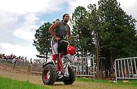Jul 31, 2009; Flagstaff, AZ, USA; Arizona Cardinals wide receiver Larry Fitzgerald leaves the field on a segway scooter following training camp on the campus of Northern Arizona University. Mandatory Credit: Mark J. Rebilas-