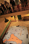 Guide and wartime map at Lascaris War Rooms underground museum, Valletta, Malta