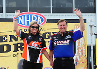 Apr. 29, 2012; Baytown, TX, USA: NHRA pro stock driver Erica Enders (left) with Larry Morgan during the Spring Nationals at Royal Purple Raceway. Mandatory Credit: Mark J. Rebilas-