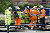 Pictured: Workers prepare for the lifting of <br /> tThe Bascule Bridge over river Tawe in the Morfa area of Swansea, south Wales. Sunday 14 July 2019<br /> Re: A 110 year old bridge has been moved for restoration in Swansea, Wales, UK.<br /> Preparation work has been under way for weeks and the Bascule Bridge near the Liberty Stadium has been lifted by a crane, in one piece.<br /> It took more than 20 workers, a 53m (174ft) crane and and a truck to complete the manoeuvre.<br /> The 70-tonne Grade II listed bridge will then be assessed and restored at Afon Engineering in Swansea Vale, and re-installed next year.<br /> The bridge was pivotal to the area's time as the world copper capital, and its hinged steel structure would lift to allow for river traffic to pass through.