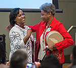 Shondra Huery , left, recognizes Patricia Bonner, right, during the Principal meeting, December 3, 2014.